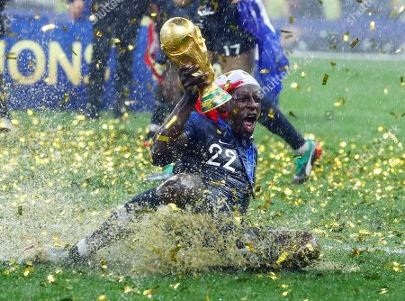 Benjamin Mendy of France celebrates with the FIFA World Cup trophy