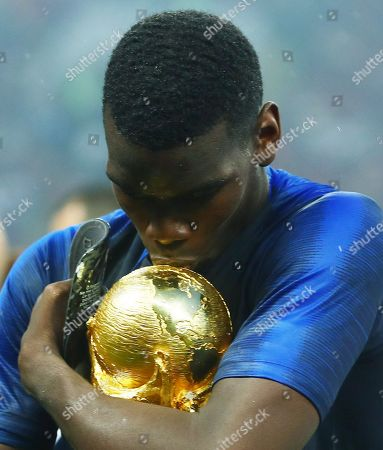 Paul Pogba of France hugs and kisses the FIFA World Cup trophy at the end of the game
