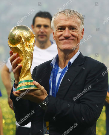 France manager Didier Deschamps holds the FIFA World Cup trophy