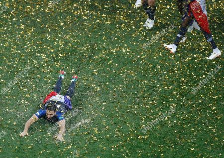 France's Adil Rami celebrates after the final match between France and Croatia at the 2018 soccer World Cup in the Luzhniki Stadium in Moscow, Russia, . France won the final 4-2