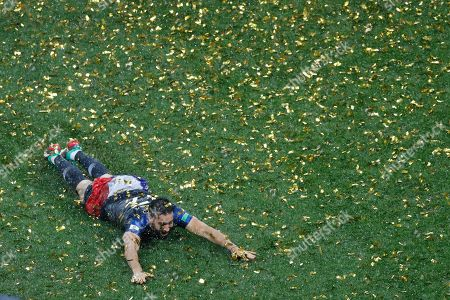 France's Adil Rami celebrates at the end of the final match between France and Croatia at the 2018 soccer World Cup in the Luzhniki Stadium in Moscow, Russia