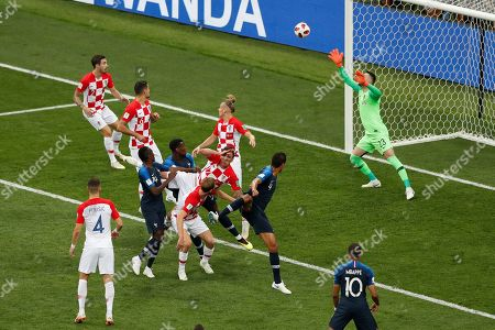 Croatia goalkeeper Danijel Subasic fails to stop an own goal by Croatia's Mario Mandzukic, 17, France's opening goal during the final match between France and Croatia at the 2018 soccer World Cup in the Luzhniki Stadium in Moscow, Russia