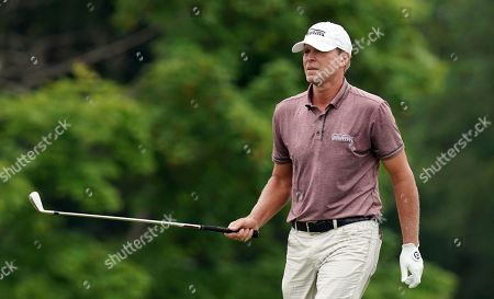 Steve Stricker hits on the ninth fairway during the final round of the John Deere Classic golf tournament, at TPC Deere Run in Silvis, Ill