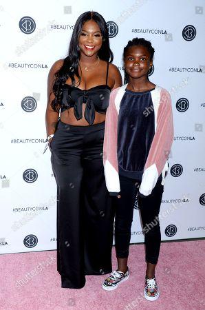 Torrei Hart and daughter