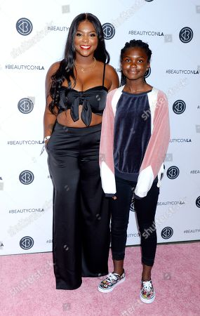 Stock Photo of Torrei Hart and daughter