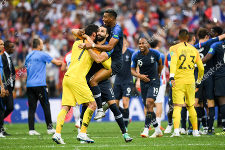 Hugo Lloris of France and Adil Rami of France celebrating the victory at Luzhniki Stadium during the final between Franceand Croatia during the World Cup