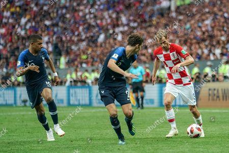 Ivan Strinic of Croatia trying to go past Benjamin Pavard of France at Luzhniki Stadium during the final between Franceand Croatia during the World Cup