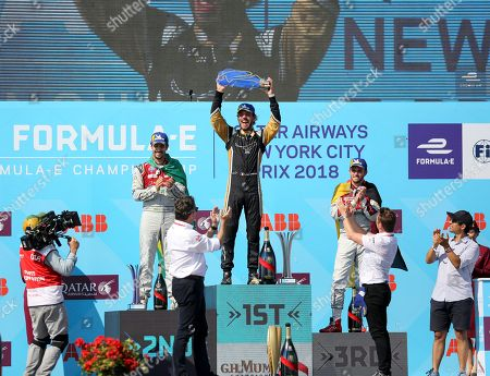 Techeetah's Jean-Eric Vergne, center, celebrates after he won the second of two auto races in the Formula E championship in the Brooklyn borough of New York on . Audi Sport ABT Schaeffler's Lucas di Grassi and Daniel Abt finished second and third, respectively