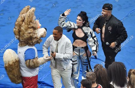 The ceremony before the match. From left to right: American actor and singer Will Smith, Albanian singer Era Istrefi, American singer Nicky Jam and The mascot of FIFA 2018 Russia wolf Zabivaka during the ceremony.