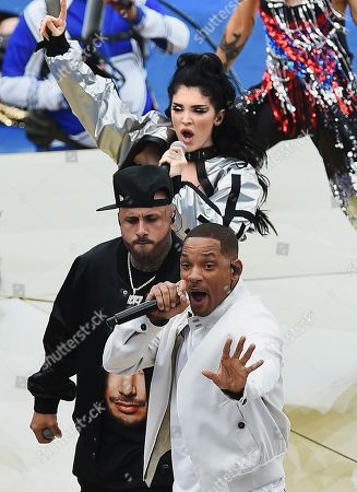 The ceremony before the match. From left to right: American actor and singer Will Smith, American singer Nicky Jam and Albanian singer Era Istrefi during the ceremony.