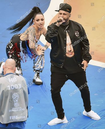 The ceremony before the match. American singer Nicky Jam (left) and Albanian singer Era Istrefi (second left) during the ceremony.