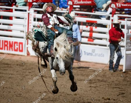 Richmond Champion, of Texas, wins the Bareback Riding event during finals rodeo action at the Calgary Stampede in Calgary, Alberta