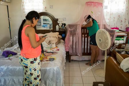 Power Adjuntas. Joselyn Torres, 17, right, checks on her newborn at her home that is without electricity since Hurricane Irma and Maria in Adjuntas, Puerto Rico. Torres and her 20-year-old husband Steven Vilella are looking forward to the restoration of power, but like many, fear their newly returned normality could be short-lived