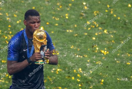 France's Paul Pogba celebrates winning the World Cup