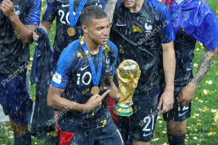 Kylian Mbappe with the World Cup Trophy