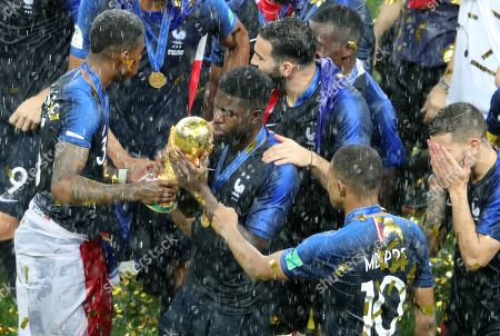 France's Samuel Umtiti  with the World Cup Trophy