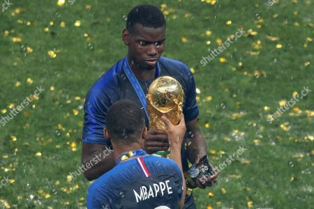 Kylian Mbappe with Paul Pogba and the World Cup Trophy