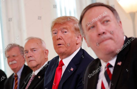 Donald Trump, Melania Trump, Sauli Niinisto, Jenni Haukio. U.S. President Donald Trump, second right, is flanked by, from left, Security Adviser John Bolton, the US ambassador to Finland Robert Frank Pence and U.S. Secretary of State Mike Pompeo during a working breakfast with Finnish President Sauli Niinisto in Helsinki, Finland, prior to his meeting with Russian President Vladimir Putin in the Finnish capital
