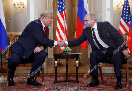 Donald Trump, Vladimir Putin. U.S. President Donald Trump, left, and Russian President Vladimir Putin shake hand at the beginning of a meeting at the Presidential Palace in Helsinki, Finland