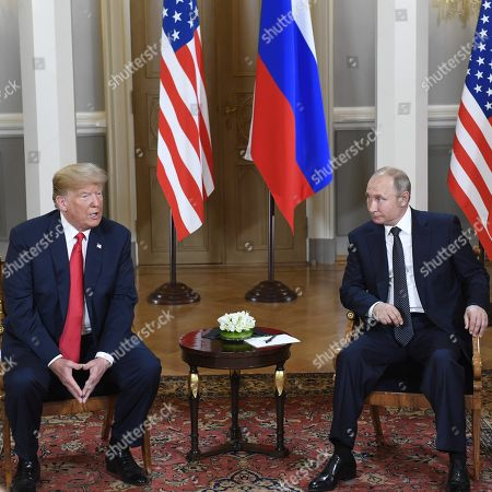 U.S. President Donald Trump (l) and Russian President Vladimir Putin meet on one-to-one in the Presidential Palace in Helsinki
