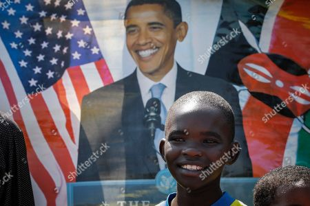 A young supporter of former US president Barack Obama smiles as he waits for Obama's arrival, prior to an opening ceremony of the Sauti Kuu Sports, Vocational and Training Centre in his ancestral home Kogelo, some 400km west of the capital Nairobi, Kenya, 16 July 2018. Barack Obama visited his ancestral home in western Kenya to attend the opening ceremony of the centre founded by his half-sister Auma Obama, after having met with Kenyan President Uhuru Kenyatta and opposition politician Raila Odinga in Nairobi the previous day. After Kenya, Obama is scheduled to travel to South Africa where he will deliver the annual Nelson Mandela lecture in Johannesuburg.