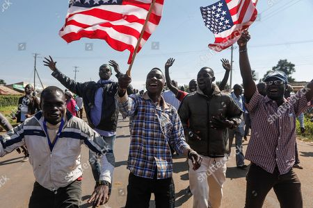 Supporters of former US president Barack Obama wave US flags as they cheer to welcome Obama during an opening ceremony of the Sauti Kuu Sports, Vocational and Training Centre in his ancestral home Kogelo, some 400km west of the capital Nairobi, Kenya, 16 July 2018. Barack Obama visited his ancestral home in western Kenya to attend the opening ceremony of the centre founded by his half-sister Auma Obama, after having met with Kenyan President Uhuru Kenyatta and opposition politician Raila Odinga in Nairobi the previous day. After Kenya, Obama is scheduled to travel to South Africa where he will deliver the annual Nelson Mandela lecture in Johannesuburg.