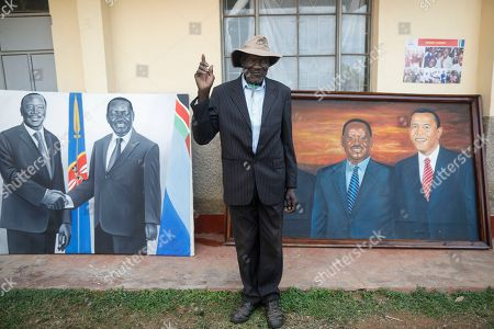 A village elder poses for a photographer in front of a paiting featuring former US president Barack Obama and Kenyan opposition leader Raila Odinga (R), prior to an opening ceremony of the Sauti Kuu Sports, Vocational and Training Centre in his ancestral home Kogelo, some 400km west of the capital Nairobi, Kenya, 16 July 2018. Barack Obama visited his ancestral home in western Kenya to attend the opening ceremony of the centre founded by his half-sister Auma Obama, after having met with Kenyan President Uhuru Kenyatta and opposition politician Raila Odinga in Nairobi the previous day. After Kenya, Obama is scheduled to travel to South Africa where he will deliver the annual Nelson Mandela lecture in Johannesuburg.