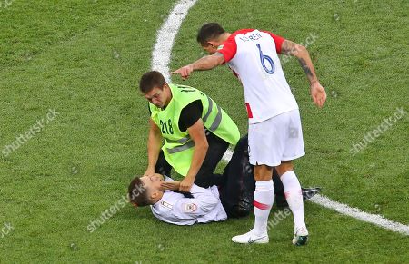 Stock Picture of Dejan Lovren of Croatia  shouts at Member of Pussy Riot who invades  the pitch