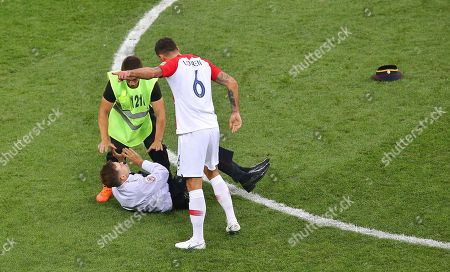 Dejan Lovren of Croatia  shouts at Member of Pussy Riot who invades  the pitch