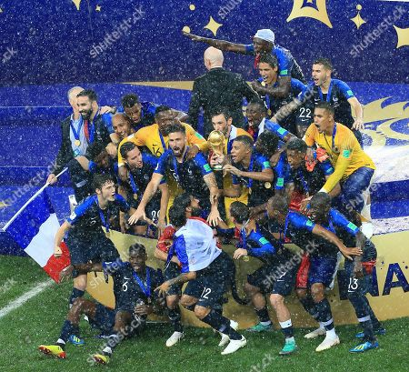 Hugo Lloris of France lifet the World Cup trophy and celebrates with team-mates