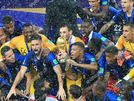 Stock Image of Hugo Lloris of France lifet the World Cup trophy and celebrates with team-mates