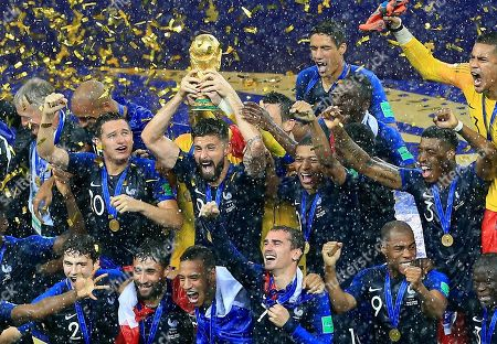 Olivier Giroud of France celebrates with the FiFA trophy
