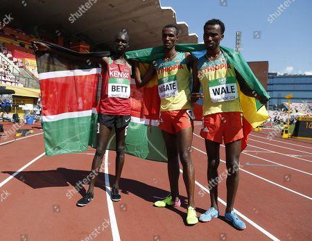 Leonard Kipkemoi Bett of Kenya, Takele Nigate of Ethiopia and Getnet Wale of Ethiopia after men's 3000 meters Steeplechase final