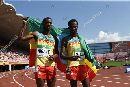 Takele Nigate (L) of Ethiopia and Getnet Wale of Ethiopia after men's 3000 meters Steeplechase final