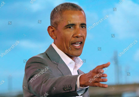 Former US President Barack Obama gestures to the crowd, during an event in Kogelo, Kisumu, Kenya, . Obama is in Kenya to launch a sports and training center founded by his half-sister, Auma Obama