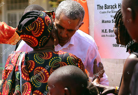 Former US President Barack Obama greets his step- grandmother Sarah Obama, during an event in Kogelo, Kisumu, Kenya, . Obama is in Kenya to launch a sports and training center founded by his half-sister, Auma Obama