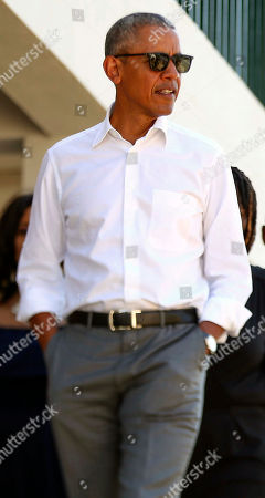 Former US President Barack Obama looks on in Kogelo, Kenya, . Former U.S. President Barack Obama Monday praised Kenya's president and opposition leader for working together but said this East African country must do more to end corruption. Obama, on his first visit to Africa since stepping down as president, commended President Uhuru Kenyatta and opposition leader Raila Odinga for cooperating following last year's disputed presidential election which were marked by violence