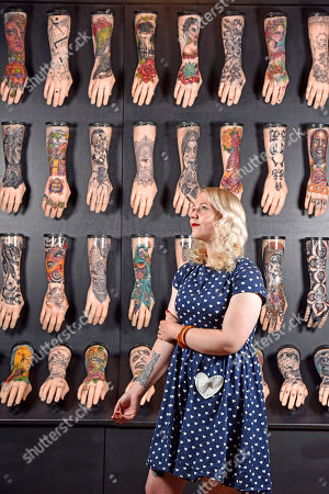 Curator of exhibitions for the National Museum, Alice Roberts-Pratt, checks on the 100 hands display.