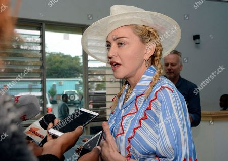 Stock Picture of US singer Madonna speaks to the press at a news conference in Blantyre, Malawi, . Madonna has adopted four Malawian children, is in the country to celebrate the first anniversary of the Mercy James Centre for Pediatric Surgery and Intensive Care, named after one of her adopted daughters