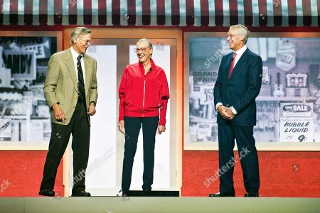 Stock Photo of Jim Walton, left, Alice Walton, center, and Rob Walton, right, children of Walmart Inc. founder Sam Walton, attend a Walmart shareholders' meeting in Fayetteville, Ark. Since 2006, philanthropists and their private foundations and charities have given almost half a billion dollars to charter school groups, according to an Associated Press analysis of tax filings and Foundation Center data, with the Walton Family Foundation being the largest donor