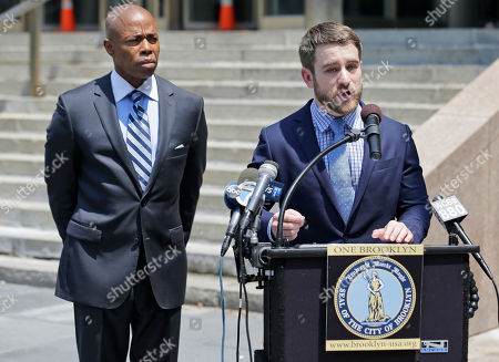 Aaron Carr, founder of Housing Rights Initiative, right, and Brooklyn borough president Eric Adams attend a news conference in New York, . Carr and Adams were helping to announce that Kushner Cos. is being sued by renters at one of its largest residential buildings in New York for allegedly using construction crews to make living conditions so intolerable they would leave, freeing up apartments to be sold as high-priced luxury condos