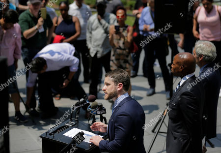 Aaron Carr, founder of Housing Rights Initiative, speaks during a news conference in New York, . Carr was helping to announce that Kushner Cos. is being sued by renters at one of its largest residential buildings in New York for allegedly using construction crews to make living conditions so intolerable they would leave, freeing up apartments to be sold as high-priced luxury condos