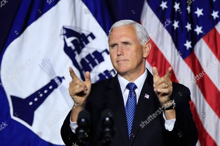 Vice President Mike Pence responds to applause from the employees of the Department of Commerce in Washington