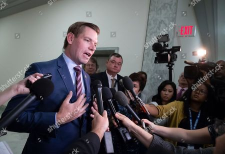 Rep. Eric Swalwell, D-Calif., pauses to speak with reporters as former FBI lawyer Lisa Page is questioned behind closed doors by members of the House Judiciary Committee and House Oversight Committee on whether political bias affected the investigations of Hillary Clinton's emails and the Trump campaign's alleged ties to Russia, on Capitol Hill in Washington