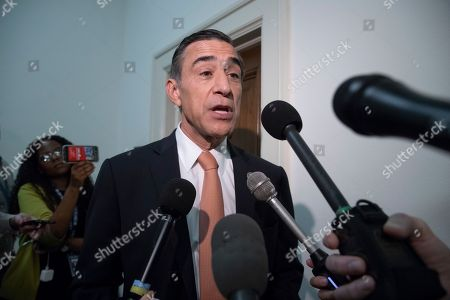 Rep. Darrell Issa, R-Calif., pauses to speak with reporters as former FBI lawyer Lisa Page is questioned behind closed doors by members of the House Judiciary Committee and House Oversight Committee on whether political bias affected the investigations of Hillary Clinton's emails and the Trump campaign's alleged ties to Russia, on Capitol Hill in Washington