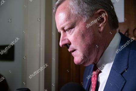 Rep. Mark Meadows, R-N.C., pauses to speak with reporters as former FBI lawyer Lisa Page is questioned during a private interview with members of the House Judiciary Committee and House Oversight Committee on whether political bias affected the investigations of Hillary Clinton's emails and the Trump campaign's alleged ties to Russia, on Capitol Hill in Washington