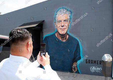 Tom Kim takes a picture of the late chef and television celebrity Anthony Bourdain outside Gramercy bar and restaurant in Santa Monica, California, USA, 16 July 2018.  Never who specializes in topical murals has painted over 150 murals in and around Los Angeles and is widely followed on Instagram and other social media outlets.
