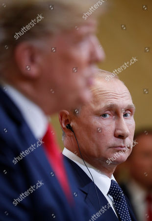 Donald Trump, Vladimir Putin. Russian President Vladimir Putin, right, looks over towards U.S. President Donald Trump, left, as Trump speaks during their joint news conference at the Presidential Palace in Helsinki, Finland