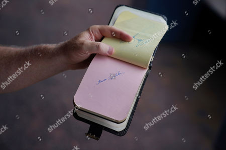 Stock Picture of Associated Press baseball writer Ben Walker shows his autograph book from the 1969 All-Star game, when he was 11-years-old, at Nationals Park, in Washington. The autograph is from the National League St. Louis Cardinals' Steve Carlton. That was the last time the Midsummer Classic was in the nation's capital, at RFK Stadium