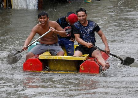 Monsoon and Tropical storm Henry hit the Philippines
